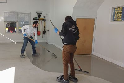 applying the base coat for the concrete coating