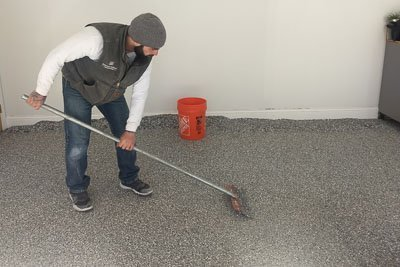 scraping the in process concrete coating